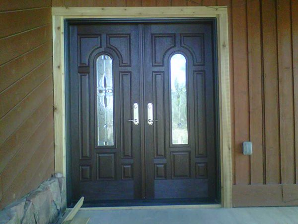 Front entry doors dark wood color with windows