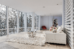 Beautiful open living room with a wall of windows done all in white
